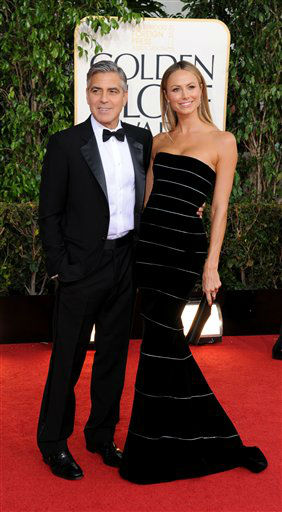 George Clooney, left, and Stacy Keibler arrive at the 70th Annual Golden Globe Awards at the Beverly Hilton Hotel on Sunday Jan. 13, 2013, in Beverly Hills, Calif. <span class=meta>(Photo by Jordan Strauss&#47;AP)</span>