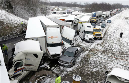 Police and emergency personal work the scene of a pileup involving more than 40-vehicles on Interstate 70 in Plainfield, Ind., Thursday, Jan. 31, 2013. The crash closed the interstate in both direction and authorities reported at least seven minor injuries.   <span class=meta>(AP Photo&#47; Michael Conroy)</span>