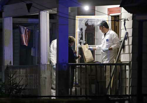 Members of the FBI evidence team remove items from a house on in Cleveland Monday, May 6, 2013. Three women who went missing separately about a decade ago, when they were in their teens or early 20s, were found alive in the house, and a man was arrested.  <span class=meta>(Photo&#47;Mark Duncan)</span>
