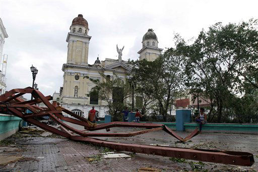 A fallen placard lies on the ground after the passing of Hurricane Sandy in Santiago de Cuba, Cuba, Thursday Oct. 25, 2012.  Hurricane Sandy blasted across eastern Cuba on Thursday as a potent Category 2 storm and headed for the Bahamas after causing at least two deaths in the Caribbean.   <span class=meta>(AP Photo&#47; Franklin Reyes)</span>