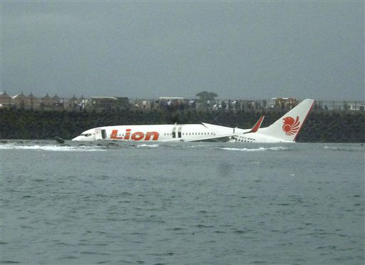 The wreckage a crashed Lion Air plane sits on the water near the airport in Bali, Indonesia on Saturday, April 13, 2013. The plane carrying more than 100 passengers and crew overshot a runway on the Indonesian resort island of Bali on Saturday and crashed into the sea, injuring nearly two dozen people, officials said.   <span class=meta>(AP Photo&#47; Uncredited)</span>