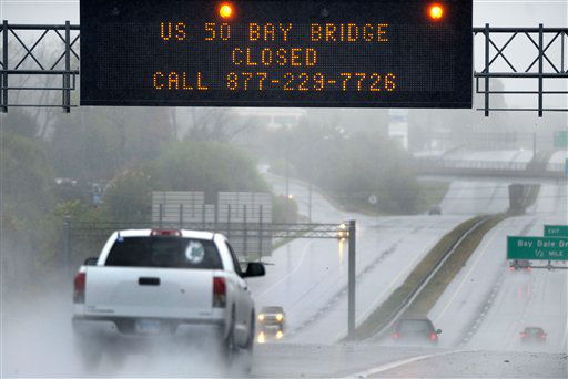"<div class=""meta ""><span class=""caption-text "">A sign informs motorists along U.S. Route 50 that Maryland's Chesapeake Bay Bridge, which connects the state's eastern and western shores, is closed because of winds from Hurricane Sandy Monday, Oct. 29, 2012. Hurricane Sandy continued on its path Monday, as the storm forced the shutdown of mass transit, schools and financial markets, sending coastal residents fleeing, and threatening a dangerous mix of high winds and soaking rain.  (AP Photo/ Steve Ruark)</span></div>"
