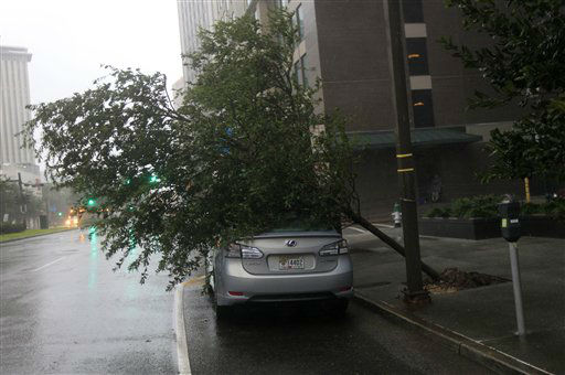A tree lies on a car on Poydras St. downtown after Hurricane Isaac made landfall in New Orleans, Wednesday, Aug. 29, 2012.  Isaac was packing 80 mph winds, making it a Category 1 hurricane. It came ashore early Tuesday near the mouth of the Mississippi River, driving a wall of water nearly 11 feet high inland and soaking a neck of land that stretches into the Gulf. The storm stalled for several hours before resuming a slow trek inland, and forecasters said that was in keeping with the its erratic history. The slow motion over land means Isaac could be a major soaker, dumping up to 20 inches of rain in some areas.   <span class=meta>(AP Photo&#47; Gerald Herbert)</span>