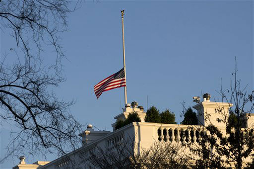 An American flag flies at half-staff over the White House in Washington, Friday, Dec. 14, 2012, in honor of the Connecticut elementary school shooting victims.   <span class=meta>(AP Photo&#47; Charles Dharapak)</span>