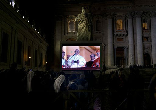 "<div class=""meta ""><span class=""caption-text "">Pope Francis seen on a screen as he watches the crowd from the central balcony of St. Peter's Basilica at the Vatican, Wednesday, March 13, 2013. Argentine Cardinal Jorge Mario Bergoglio, who chose the name of Pope Francis, is the 266th pontiff of the Roman Catholic Church.  (AP Photo/ Oded Balilty)</span></div>"