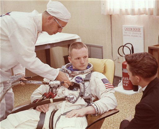 In this March 9, 1966 file photo, Astronaut Neil Armstrong is seated during a suiting up exercise Cape Kennedy, Florida, in preparation for the Gemini 8 flight.  The family of Neil Armstrong, the first man to walk on the moon, says he has died at age 82. A statement from the family says he died following complications resulting from cardiovascular procedures. It doesn&#39;t say where he died. Armstrong commanded the Apollo 11 spacecraft that landed on the moon July 20, 1969. He radioed back to Earth the historic news of &#34;one giant leap for mankind.&#34; Armstrong and fellow astronaut Edwin &#34;Buzz&#34; Aldrin spent nearly three hours walking on the moon, collecting samples, conducting experiments and taking photographs. In all, 12 Americans walked on the moon from 1969 to 1972.    <span class=meta>(AP Photo&#47; Uncredited)</span>