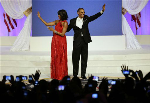 President Barack Obama and first lady Michelle Obama wave to guests after their dance at Commander-in-Chief&#39;s Inaugural Ball at the 57th Presidential Inauguration in Washington, Monday, Jan. 21, 2013.   <span class=meta>(AP Photo&#47; Jacquelyn Martin)</span>