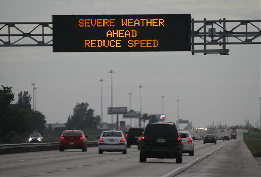 "<div class=""meta image-caption""><div class=""origin-logo origin-image ""><span></span></div><span class=""caption-text"">Drivers along a stretch of the Florida Turnpike slow down after passing a sign warning of severe weather caused by Tropical Storm Isaac in Hialeah, Fla. Forecasters predicted Isaac would intensify into a Category 1 hurricane later Monday or Tuesday with top sustained winds of between 74 and 95 mph. The center of its projected path took Isaac directly toward New Orleans on Wednesday, but hurricane warnings extended across some 330 miles from Morgan City, La., to Destin, Fla. It could become the first hurricane to hit the Gulf Coast since 2008.  (AP Photo/ Wilfredo Lee)</span></div>"