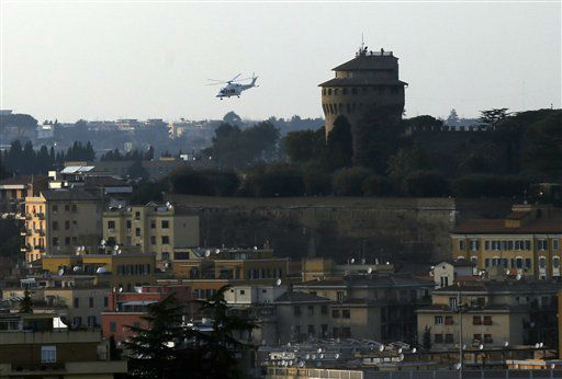The helicopter taking Pope Benedict XVI to Castel Gandolfo leaves the Vatican in Rome, Thursday, Feb. 28, 2013. Shortly before 5 p.m. on Thursday, Pope Benedict left the Apostolic palace inside the Vatican for the last time as pontiff, headed to the helipad at the top of the hill in the Vatican gardens and flew to the papal retreat at Castel Gandolfo south of Rome. There, at 8 p.m. sharp, Benedict will become the first pontiff in 600 years to resign. <span class=meta>(AP photo)</span>