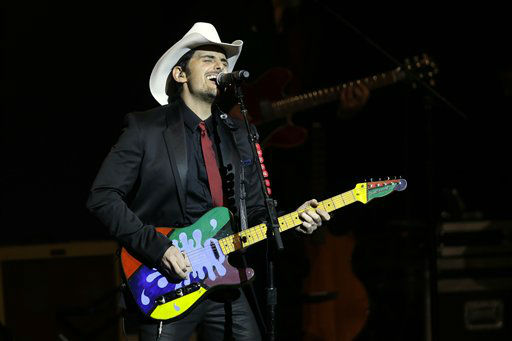 "<div class=""meta ""><span class=""caption-text "">Brad Paisley performs during The Inaugural Ball at the Washignton convention center during the 57th Presidential Inauguration in Washington, Monday, Jan. 21, 2013.   (AP Photo/ Paul Sancya)</span></div>"