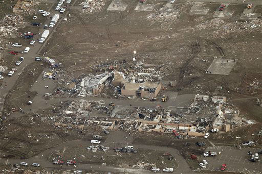 This aerial photo shows damage to Plaza Towers Elementary School after it was hit by a massive tornado in Moore, Okla., Monday May 20, 2013. A tornado roared through the Oklahoma City suburbs Monday, flattening entire neighborhoods, setting buildings on fire and landing a direct blow on an elementary school.  <span class=meta>(AP Photo&#47; Steve Gooch)</span>