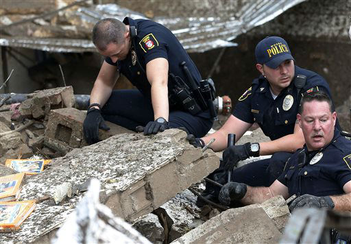 Moore police dig through the rubble of the Plaza Towers Elementary School following a tornado in Moore, Okla., Monday, May 20, 2013. A tornado as much as a mile &#40;1.6 kilometers&#41; wide with winds up to 200 mph &#40;320 kph&#41; roared through the Oklahoma City suburbs Monday, flattening entire neighborhoods, setting buildings on fire and landing a direct blow on an elementary school. &#40;AP Photo&#47;Sue Ogrocki&#41; <span class=meta>(AP Photo&#47; Sue Ogrocki)</span>