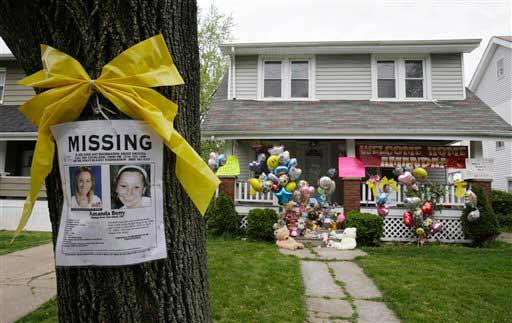 "<div class=""meta ""><span class=""caption-text "">A missing poster still rests on a tree outside the home of Amanda Berry Wednesday, May 8, 2013, in Cleveland. Berry, 27, Michelle Knight, 32, and Gina DeJesus had apparently been held captive in a house since their teens or early 20s, police said. (AP Photo/Tony Dejak) (AP Photo/Tony Dejak)</span></div>"