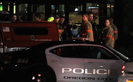 First responders stand outside where a gunman opened fire at the Clackamas Town Center shopping mall earlier in Portland, Ore., Tuesday, Dec. 11, 2012. Police say three people are dead, including the gunman. (AP Photo/Don Ryan)
