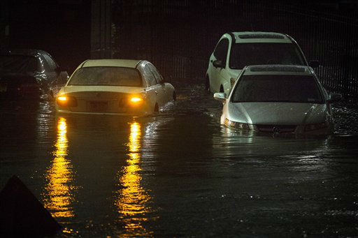 Vehicles are submerged during a storm surge near the Brooklyn Battery Tunnel, Monday, Oct. 29, 2012, in New York. Superstorm Sandy zeroed in on New York&#39;s waterfront with fierce rain and winds that shuttered most of the nation&#39;s largest city Monday, darkened the financial district and left a huge crane hanging off a luxury high-rise. &#40;AP Photo&#47;John Minchillo&#41; <span class=meta>(AP Photo&#47; John Minchillo)</span>