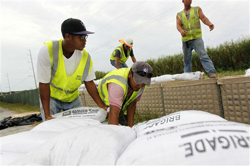 "<div class=""meta image-caption""><div class=""origin-logo origin-image ""><span></span></div><span class=""caption-text"">Workers stack sandbags on top of retaining wall baskets in preparation for Tropical Storm Isaac, which is expected to make landfall on the Louisiana coast as a hurricane, in Port Sulphur, La., Monday, Aug. 27, 2012.   (AP Photo/ Gerald Herbert)</span></div>"