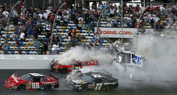 "<div class=""meta ""><span class=""caption-text "">Kyle Larson (32) goes into the catch fence as he collides with Justin Allgaier (31), Brian Scott (2), Parker Klingerman (77) and Dale Earnhardt Jr. (88) at the conclusion of the NASCAR Nationwide Series auto race Saturday, Feb. 23, 2013, at Daytona International Speedway in Daytona Beach, Fla. (AP Photo/Terry Renna) (AP Photo/ Terry Renna)</span></div>"
