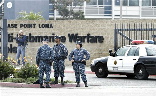 Military police stand guard outside Naval Base Point Loma in San Diego as San Diego police officers and federal agents search for former Los Angeles officer Christopher Dorner who police believe is responsible for three murders Thursday Feb. 7, 2013.   <span class=meta>(AP Photo&#47; Lenny Ignelzi)</span>
