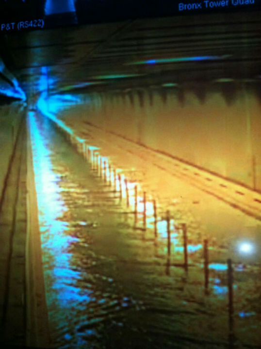 "<div class=""meta ""><span class=""caption-text "">This photo provided by MTA Bridges and Tunnels shows floodwaters from Sandy entering the Hugh L. Carey Tunnel (former Brooklyn-Battery Tunnel), which was closed on Monday, Oct. 29, 2012. New York City shut all three of its airports, its subways, schools, stock exchanges, Broadway theaters and closed several bridges and tunnels Monday as the weather worsened.   (AP Photo/ Uncredited)</span></div>"