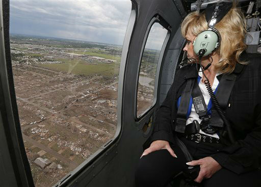 "<div class=""meta ""><span class=""caption-text "">Oklahoma Gov. Mary Fallin looks out the window of a National Guard helicopter as she tours the tornado damage in Moore, Okla., Tuesday, May 21, 2013.   (AP Photo/ Sue Ogrocki)</span></div>"