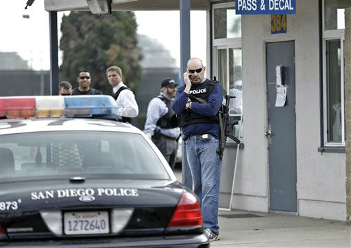 "<div class=""meta ""><span class=""caption-text "">San Diego police officers and federal agents occupy the gate to the Point Loma Naval facility in San Diego Thursday Feb. 7, 2013 during a manhunt for former Los Angeles officer Christopher Dorner in San Diego.  Dorner is suspected of shooting two LAPD officers who were sent to Corona to protect someone Dorner threatened in a rambling online manifesto. Thousands of police officers throughout Southern California and Nevada searched for Dorner, a former Los Angeles officer who was angry over his firing and began a deadly shooting rampage that he warned in an online posting would target those on the force who wronged him.  (AP Photo/ Lenny Ignelzi)</span></div>"