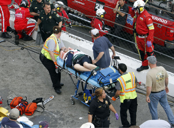 An injured spectator is treated after a crash at the conclusion of the NASCAR Nationwide Series auto race Saturday, Feb. 23, 2013, at Daytona International Speedway in Daytona Beach, Fla. Driver Kyle Larson&#39;s car hit the safety fence sending car parts and other debris flying into the stands. &#40;AP Photo&#47;David Graham&#41;  <span class=meta>(AP Photo&#47; David Graham)</span>