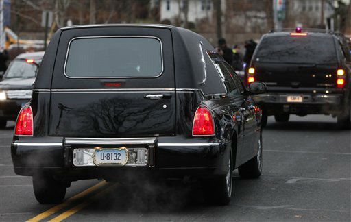 A hearse bears away the body of 6-year-old Noah Pozner after his funeral, Monday, Dec. 17, 2012, in Fairfield, Conn. Pozner was killed when a gunman walked into Sandy Hook Elementary School in Newtown Friday and opened fire, killing 26 people, including 20 children. &#40;AP Photo&#47;Jason DeCrow&#41; <span class=meta>(AP Photo&#47; Jason DeCrow)</span>
