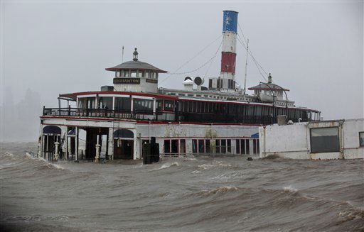 An historic ferry boat named the Binghamton is swamped by the waves of the Hudson River in Edgewater, N.J., Monday, Oct. 29, 2012, as Hurricane Sandy lashes the East Coast. Hurricane Sandy continued on its path Monday, as the storm forced the shutdown of mass transit, schools and financial markets, sending coastal residents fleeing, and threatening a dangerous mix of high winds and soaking rain.  &#40;AP Photo&#47;Craig Ruttle&#41; <span class=meta>(AP Photo&#47; Craig Ruttle)</span>