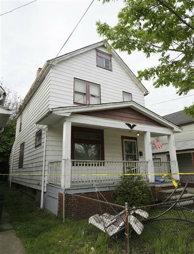 "<div class=""meta image-caption""><div class=""origin-logo origin-image ""><span></span></div><span class=""caption-text"">A house where three women escaped is shown Tuesday, May 7, 2013, in Cleveland, the day after the three women, who vanished a decade ago, were found there. Amanda Berry, Gina DeJesus and Michelle Knight, who went missing separately about a decade ago, were found in the home just south of downtown Cleveland and likely had been tied up during years of captivity, said police, who arrested three brothers.  (AP Photo/ Tony Dejak)</span></div>"