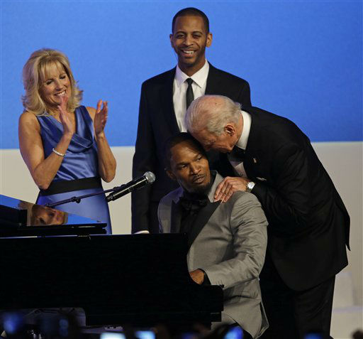 "<div class=""meta ""><span class=""caption-text "">Vice President Joe Biden talks to Jamie Foxx as Jill Biden watches during The Inaugural Ball at the Washington convention center during the 57th Presidential Inauguration in Washington, Monday, Jan. 21, 2013.   (AP Photo/ Paul Sancya)</span></div>"