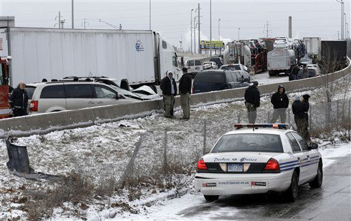 A section of multi-vehicle accident on Interstate 75 is shown in Detroit, Thursday, Jan. 31, 2013. Snow squalls and slippery roads led to a series of accidents that left at least three people dead and 20 injured on a mile-long stretch of southbound I-75. More than two dozen vehicles, including tractor-trailers, were involved in the pileups.   <span class=meta>(AP Photo&#47; Paul Sancya)</span>