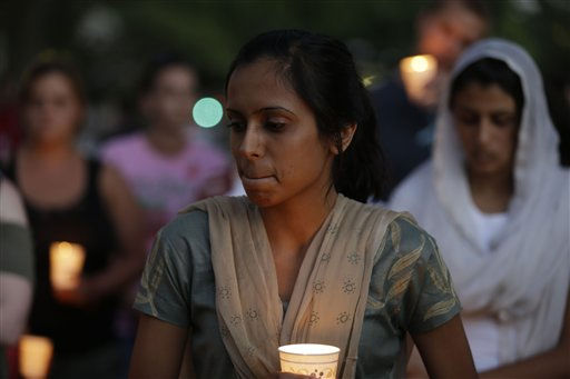 Mourners take part in a candle light vigil for the victims of the Sikh Temple of Wisconsin shooting, in Milwaukee, Sunday, Aug 5, 2012. An unidentified gunman killed six people at a Sikh temple in suburban Milwaukee on Sunday in a rampage that left terrified congregants hiding in closets and others texting friends outside for help. The suspect was killed outside the temple in a shootout with police officers.   <span class=meta>(AP Photo&#47; JEFFREY PHELPS)</span>