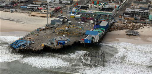 The aerial view shows storm damage over the Atlantic Coast in Seaside Heights, N.J., Wednesday, Oct. 31, 2012, taken from a helicopter traveling behind the helicopter carrying President Obama and New Jersey Gov. Chris Christie, as they viewed storm damage from superstorm Sandy.