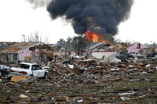 "<div class=""meta ""><span class=""caption-text "">A fire burns in the Tower Plaza Addition in Moore, Okla., following a tornado Monday, May 20, 2013. A tornado as much as a mile (1.6 kilometers) wide with winds up to 200 mph (320 kph) roared through the Oklahoma City suburbs Monday, flattening entire neighborhoods, setting buildings on fire and landing a direct blow on an elementary school. (AP Photo Sue Ogrocki) (AP Photo/ Sue Ogrocki)</span></div>"