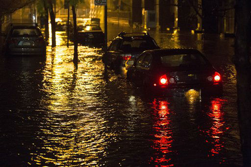Vehicles are submerged during a storm surge near the Brooklyn Battery Tunnel, Monday, Oct. 29, 2012, in New York. Superstorm Sandy zeroed in on New York&#39;s waterfront with fierce rain and winds that shuttered most of the nation&#39;s largest city Monday, darkened the financial district and left a huge crane hanging off a luxury high-rise. &#40;AP Photo&#47; John Minchillo&#41; <span class=meta>(AP Photo&#47; John Minchillo)</span>