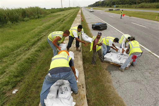 "<div class=""meta ""><span class=""caption-text "">Workers stack sandbags on top of retaining wall baskets in preparation for Tropical Storm Isaac, which is expected to make landfall on the Louisiana coast as a hurricane, in Port Sulphur, La., Monday, Aug. 27, 2012.   (AP Photo/ Gerald Herbert)</span></div>"