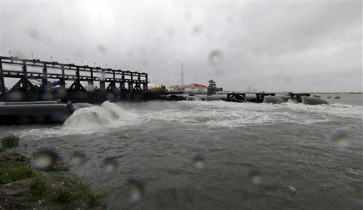 Water flows out of the new 17th Street Canal pumping station as Hurricane Isaac hits Wednesday, Aug. 29, 2012, in New Orleans. As Isaac made landfall, it was expected to dump as much as 20 inches of rain in several parts of Louisiana.   <span class=meta>(AP Photo&#47; David J. Phillip)</span>