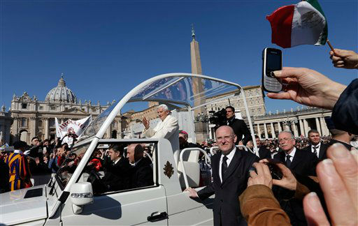 Pope Benedict XVI is driven through the crowd in his pope-mobile as he arrives to celebrate his last general audience in St. Peter&#39;s Square, at the Vatican, Wednesday, Feb. 27, 2013. Benedict XVI basked in an emotional sendoff Wednesday at his final general audience in St. Peter&#39;s Square, recalling moments of &#34;joy and light&#34; during his papacy but also times of great difficulty. He also thanked his flock for respecting his decision to retire.   <span class=meta>(AP Photo&#47; Alessandra Tarantino)</span>