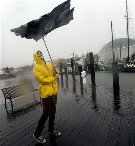 Jake Wilkerson, 20, of Annapolis, Md., struggles with his umbrella as Hurricane Sandy approaches Annapolis Monday, Oct. 29, 2012. Hurricane Sandy continued on its path Monday, as the storm forced the shutdown of mass transit, schools and financial markets, sending coastal residents fleeing, and threatening a dangerous mix of high winds and soaking rain.   <span class=meta>(AP Photo&#47; Steve Ruark)</span>