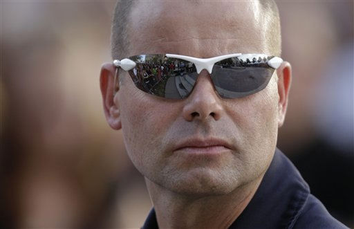 "<div class=""meta ""><span class=""caption-text "">Aurora Police officer John Bulman keeps an eye on the crowd during a prayer vigil, Sunday, July 22, 2012, in Aurora, Colo., for the victims of Friday's mass shooting at a movie theater. (AP Photo/Ted S. Warren) (AP Photo/ Ted S. Warren)</span></div>"