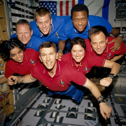 FILE - This photo provided by NASA in June 2003 shows STS-107 crew members,from the left &#40;bottom row&#41;, wearing red shirts to signify their shift?s color, are astronauts Kalpana Chawla, mission specialist; Rick D. Husband, mission commander; Laurel B. Clark, mission specialist; and Ilan Ramon, payload specialist. From the left &#40;top row&#41;, wearing blue shirts, are astronauts David M. Brown, mission specialist; William C. McCool, pilot; and Michael P. Anderson, payload commander. The astronauts were killed on Feb. 1, 2003, in the final minutes of their 16-day scientific research mission aboard Columbia. Altogether, 12 children lost a parent aboard Columbia. The youngest is now 15, the oldest 32. &#40;AP Photo&#47;NASA, File&#41; <span class=meta>(AP Photo&#47; Anonymous)</span>