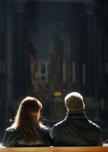 "<div class=""meta ""><span class=""caption-text "">A couple sits inside St. Peter's Basilica, at the Vatican, Thursday, Feb. 28, 2013. Shortly before 5 p.m. on Thursday, Pope Benedict XVI will leave the Apostolic palace inside the Vatican for the last time as pontiff, head to the helipad at the top of the hill in the Vatican gardens and fly to the papal retreat at Castel Gandolfo south of Rome. There, at 8 p.m. sharp, Benedict will become the first pontiff in 600 years to resign. (AP photo)</span></div>"