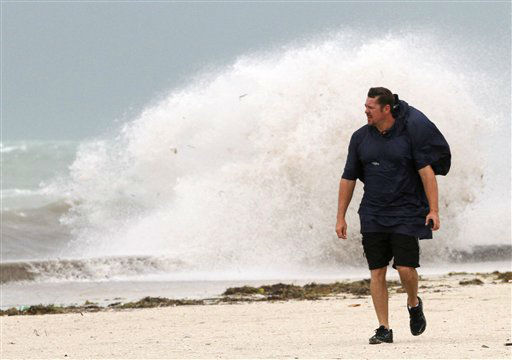 A man walks on the beach in Key West, Fla., Sunday, Aug. 26, 2012 as heavy winds hit the northern coast from Tropical Storm Isaac. Isaac is expected to continue streaming across Marion County Monday as it continues toward the northern Gulf of Mexico. National Weather Service officials in Jacksonville on Sunday said Marion County began getting rain bands from Isaac around 2 p.m. and that the rain would continue through Tuesday.   <span class=meta>(AP Photo&#47; Alan Diaz)</span>