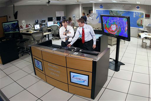 Dr. Rick Knabb, director of the National Hurricane Center, right, checks on the status of Tropical Storm Isaac as James Franklin, chief hurricane specialist, looks on at the National Hurricane Center in Miami, Tuesday, Aug. 28, 2012. Forecasters at the National Hurricane Center warned that Isaac, especially if it strikes at high tide, could cause storm surges of up to 12 feet &#40;3.6 meters&#41; along the coasts of southeast Louisiana and Mississippi and up to 6 feet &#40;1.8 meters&#41; as far away as the Florida Panhandle.  <span class=meta>(AP Photo&#47; Alan Diaz)</span>