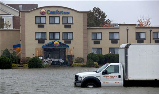 Water from the Hudson River surrounds a hotel in Edgewater, N.J., Monday, Oct. 29, 2012 as Hurricane Sandy lashes the East Coast. Hurricane Sandy continued on its path Monday, as the storm forced the shutdown of mass transit, schools and financial markets, sending coastal residents fleeing, and threatening a dangerous mix of high winds and soaking rain.  <span class=meta>(AP Photo&#47; Craig Ruttle)</span>