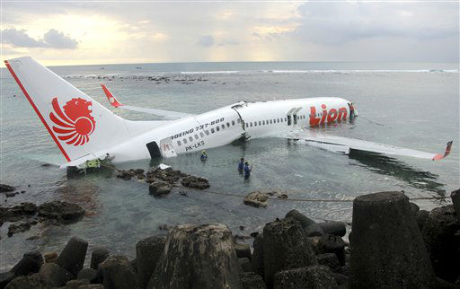 In this photo released by Indonesian Police, the wreckage of a crashed Lion Air plane sits on the water near the airport in Bali, Indonesia on Saturday, April 13, 2013. The plane carrying more than 100 passengers and crew overshot a runway on the Indonesian resort island of Bali on Saturday and crashed into the sea, injuring nearly two dozen people, officials said.   <span class=meta>(AP Photo&#47; Uncredited)</span>