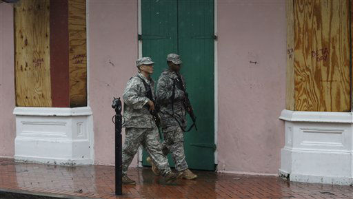 "<div class=""meta ""><span class=""caption-text "">Members of the Army National Guard patrol Bourbon Street in the French Quarter as Hurricane Isaac makes landfall, Wednesday, Aug. 29, 2012, in New Orleans, La.  Isaac was packing 80 mph winds, making it a Category 1 hurricane. It came ashore early Tuesday near the mouth of the Mississippi River, driving a wall of water nearly 11 feet high inland and soaking a neck of land that stretches into the Gulf.   (AP Photo/ Eric Gay)</span></div>"