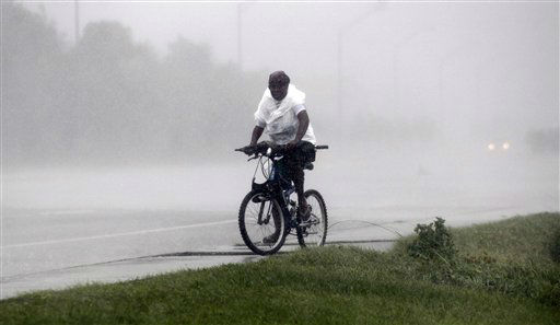 A woman braves heavy rain and strong winds as she rides a bike, Wednesday, Aug. 29, 2012, in Gulfport, Miss. Isaac pelted parts of south Mississippi with heavy rains, flooding some homes in low-lying areas and turning parts of beachside U.S. Highway 90 into a river near Biloxi casinos.   <span class=meta>(AP Photo&#47; John Bazemore)</span>