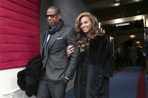 "<div class=""meta ""><span class=""caption-text "">Recording artists Jay-Z and Beyonce arrive on the West Front of the Capitol in Washington, Monday, Jan. 21, 2013, for the Presidential Barack Obama's ceremonial swearing-in ceremony during the 57th Presidential Inauguration.    (AP Photo/ Win McNamee)</span></div>"