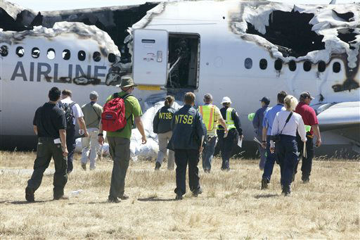 In this image provided by the NTSB, investigators examine the wreckage at the scene of the Asiana Airline crash Sunday July 7, 2013. The Asiana flight crashed upon landing Saturday, July 6, at San Francisco International Airport, and two of the 307 passengers aboard were killed.  <span class=meta>(AP Photo&#47; Uncredited)</span>